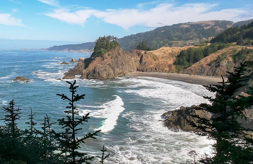 A cheap beach vacation destination is Gold Beach in Oregon