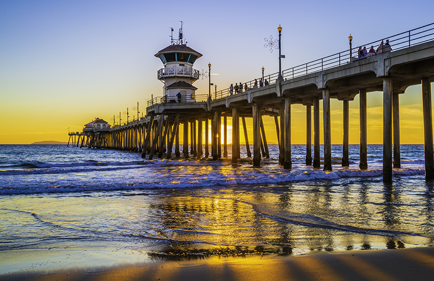 Where to travel for a beach vacation on a budget is Huntington Beach in California